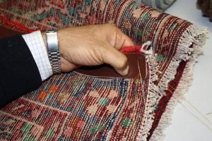 Teppichreparatur eines Teppich